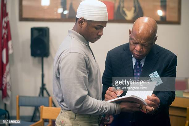Civil rights legend and Georgia Congressman John Lewis signs his comic book March Book Two for Deangelo Johnson while visiting juveniles charged as...