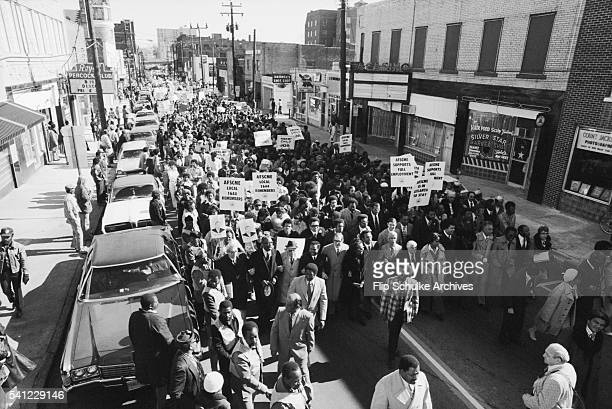 A civil rights march commemorates the birthday of Martin Luther King Jr in an Atlanta neighborhood