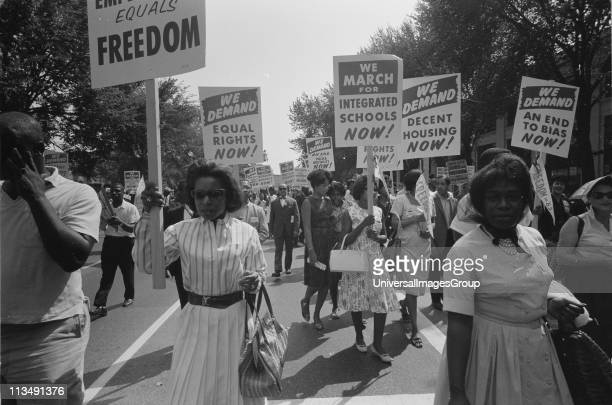 Civil rights march on Washington DC USA Procession of African Americans carrying placards demanding equal rights integrated schools decent housing...