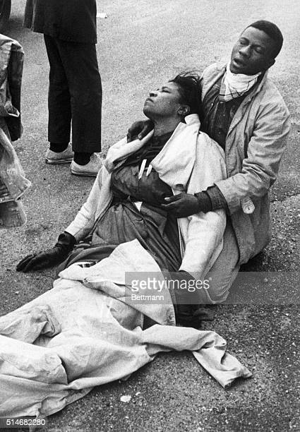 Civil rights marcher suffering from exposure to tear gas, holds an unconscious Amelia Boynton Robinson after mounted police officers attacked...
