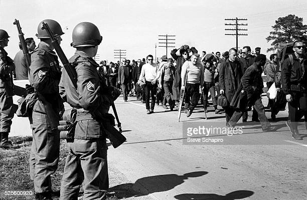 Civil rights marchers are watched by the National Guard during the third SelmaMontgomery march