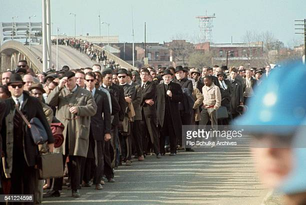 Civil rights marchers cross Edmund Pettus Bridge in the second attempt to march to Montgomery. The march was turned around by the police shortly...