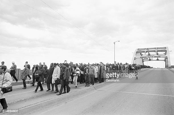 Civil rights marchers led by Martin Luther King, Jr. Cross the Edmund Pettus bridge in Selma, Alabama after being turned back by state troopers. The...