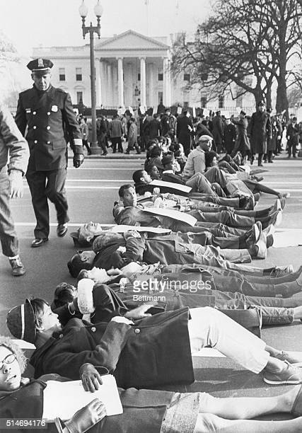 Civil rights protesters block traffic on Pennsylvania Avenue by lying in the street