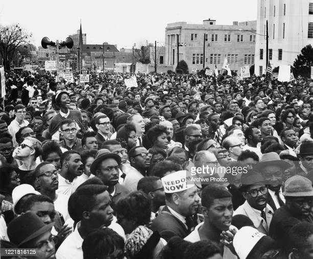 Civil rights protesters, demonstrating against voter registration laws in the state of Alabama, at the conclusion of the third leg of their march...
