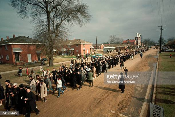 A civil rights rights march to Montgomery walks past Brown Chapel in Selma