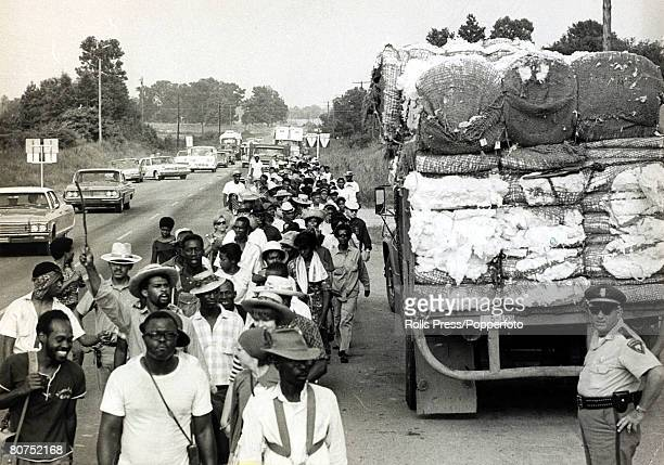 20th June 1966 Greenwood Mississippi Black freedom marchers pass a truck laden with cotton as they continue their march to Jackson