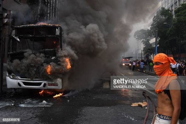 Civil servants protesting against austerity measures clash with riot police and set fire to a bus on Rio Branco the main avenue in Rio de Janeiro...