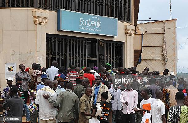 Civil servants wait in queue in front of a bank on March 10 2014 in Bangui State officials in the Central African Republic were paid their first wage...