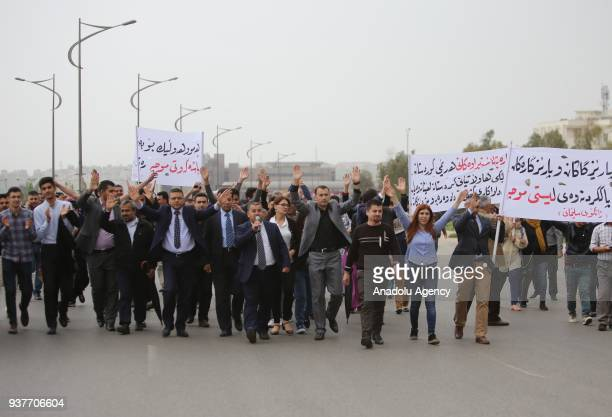Civil servants working for the Iraqi Kurdish Regional Government protest against the release of their delayed salaries with deductions in...