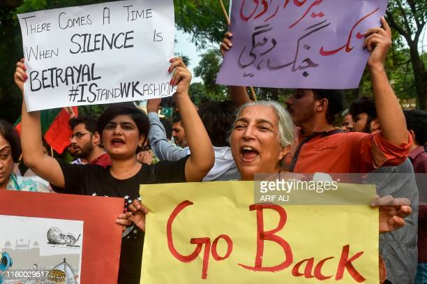 Civil society activists shout slogans against India during a protest in Lahore on August 6 a day after India stripped the disputed Kashmir region of...