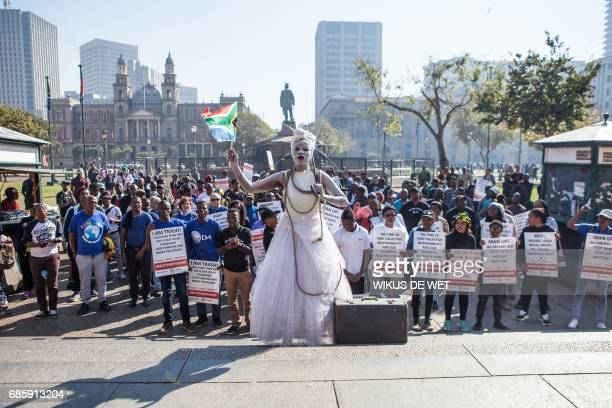 Civil society groups and political parties participate in a march organized on May 20 2017 in Pretoria against the abuse of women following the spike...