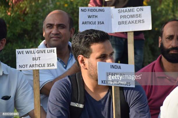 Civil society of Kashmir hold a sit protest at press colony Srinagar against the proposed removal of Article 35A On having a talk with one of their...