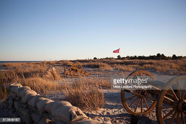 civil war canons on a battlefield. - fort sumter stock pictures, royalty-free photos & images