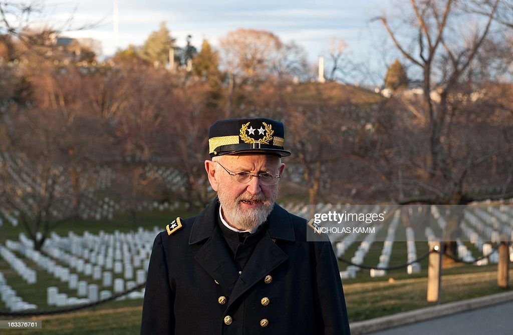 Civil War enthusiast Sam Caldwell departs a funeral service for two unknown sailors who were killed in 1862 when the Civil War ironclad USS Monitor sank off the coast of North Carolina at Arlington National Cemetery on March 8, 2013 in Arlington, Virgina. The sailors' remains, recovered when a portion of the ship was raised eleven years ago, were buried with full military honors. AFP PHOTO/Nicholas KAMM