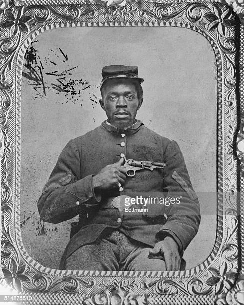 Negro Union Infantry corporal holding a Colt model 1849 pocket revolver Civil War camp photographers kept such equipment to add a martial touch to...