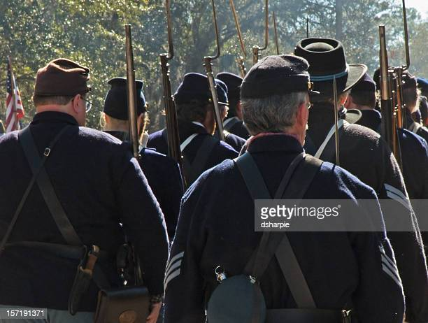 civil war reenactment - union troops marching - reenactment stock photos and pictures