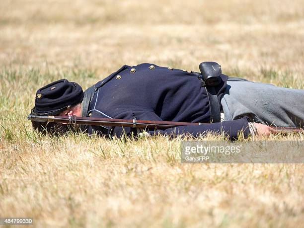 Civil War Reenactor as Dead Soldier Face Covered with Hat