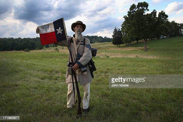 Civil War reenactor Randy Whitaker from Hood's Texas Brigade displays the Texas flag during a threeday Battle of Gettysburg reenactment on June 29...