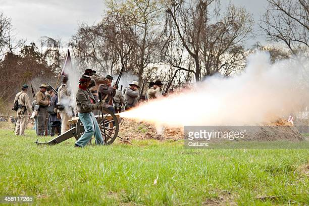civil war reenactors - firing the cannon - civil war stock pictures, royalty-free photos & images