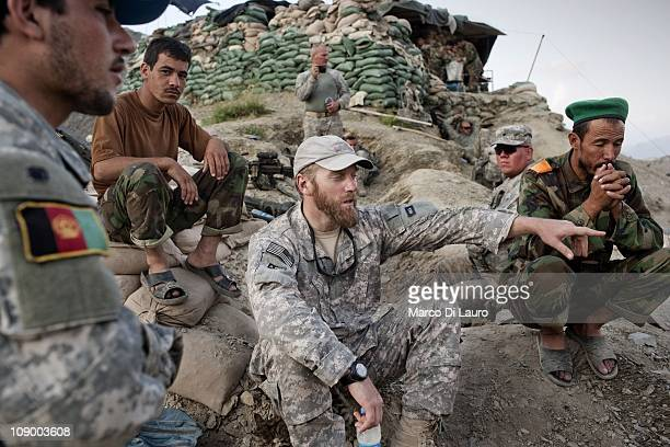 US civilian anthropologist and HTT Social Scientist Ted Callahan 35years old from Boston Massachusetts talks to Afghan National Army soldiers on duty...