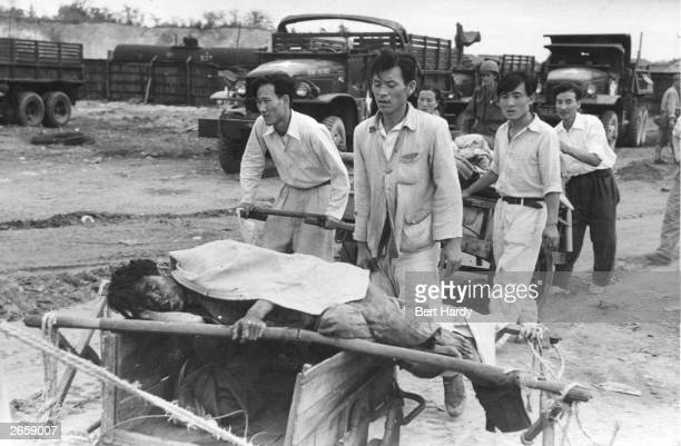 A civilian casualty of the US bombardment of Inchon in South Korea during the Korean War Original Publication Picture Post 5086 Korean War Series pub...