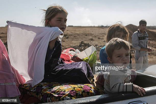 Civilian children fleeing neighbourhoods in Eastern Mosul that have been re-taken by Iraqi forces wait at a checkpoint outside Gogjoli, the city's...