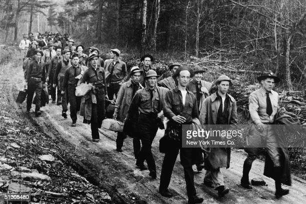 Civilian Conservation Corps recruits arrive to set up their first reforestation work camp, Powell's Fort, Virginia, April 18, 1933. The CCC was a New...