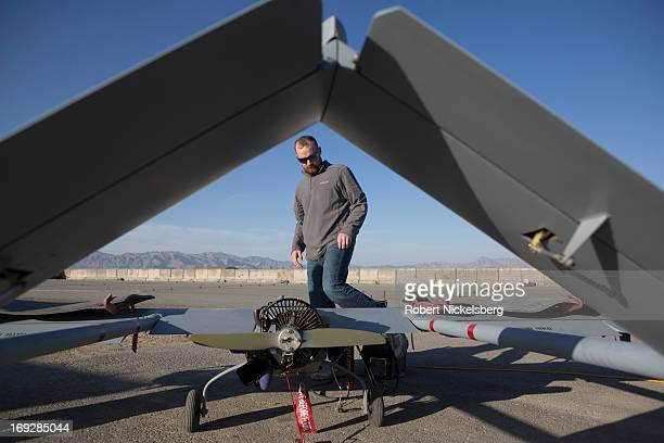 Civilian contractor checks a US Army 14' Shadow surveillance drone before it's launched at Forward Operating Base Shank May 8, 2013 in Logar...