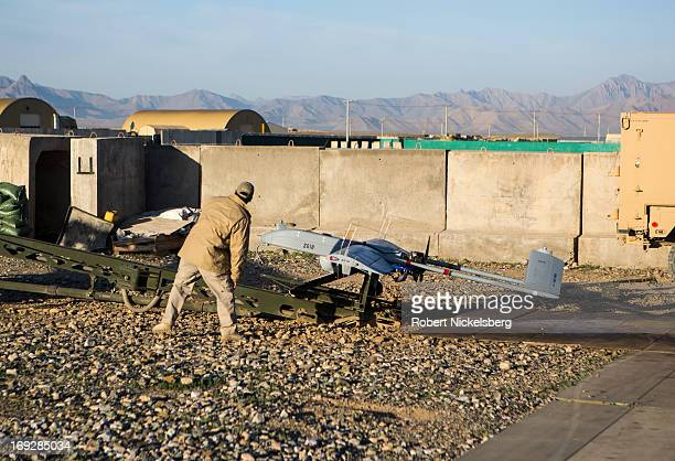 Civilian contractor checks on a US Army 14' Shadow surveillance drone set to be launched at Forward Operating Base Shank May 8, 2013 in Logar...