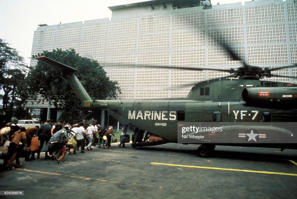 Boarding helicopter inside US Embassy , Fall of Saigon, Vietnam, 1975 m War, 1975 : News Photo