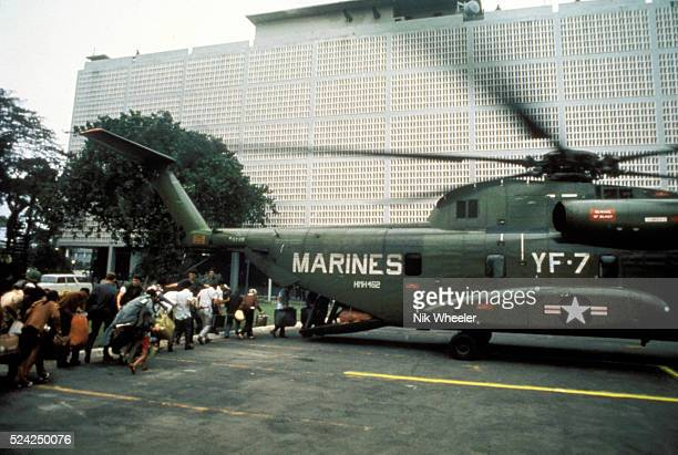 Civilian evacuees board US Marine helicopter inside US Embassy compound to be helilifted to the US Seventh Fleet ahead of Communist troops about to...