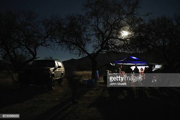 Civilian paramilitaries with Arizona Border Recon eat in their camp while on an operation at the USMexico border on November 14 2016 near Arivaca...