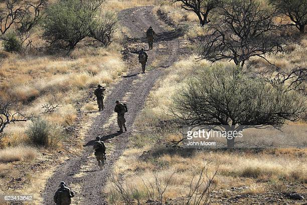 Civilian paramilitaries with Arizona Border Recon search for a illegal immigrants and drug smugglers near the USMexico border on November 14 2016...