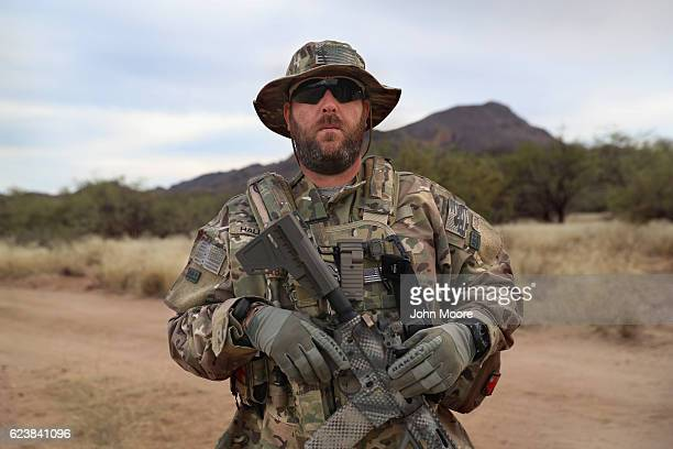 Civilian paramilitary volunteer Jimmy Hall stands near the USMexico border after a patrol for Arizona Border Recon on November 16 2016 in Pima County...