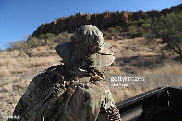A civilian paramilitary with Arizona Border Recon watches for drug smugglers and groups of undocumented immigrants crossing the USMexico border on...