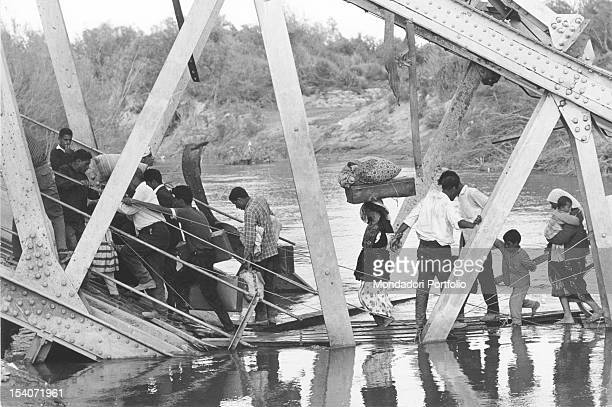 Civilian refugees crossing the bridge Allenby/King Hussein at the Jordan to reach refugee camps in the desert The bridge was destroyed by the...