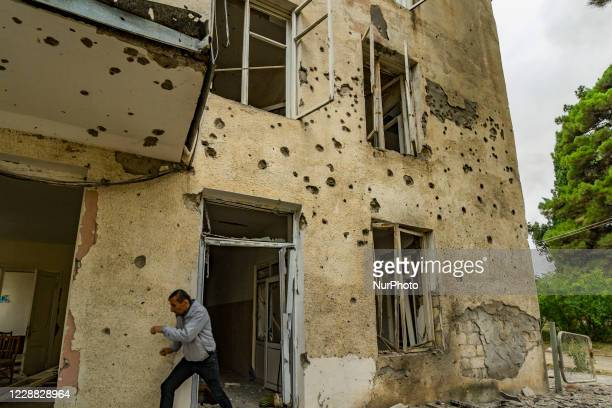 Civilian runs lookinf for protection during a shelling of the Azerbaijan army over the city of Martuni during the conflict with Nagorno Karbakh on...