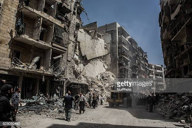 Civilian search and rescue looking for survivors after a government air strike in Aleppo Syria