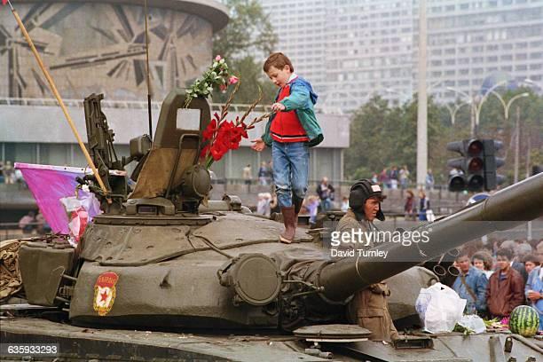 Civilian Standing on Top of a Soviet Tank