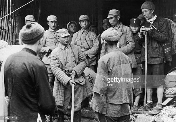 A civilian suspected of spying for the Japanese is questioned by a Chinese army Colonel at a Chinese Division Headquarters in the Salween River area...