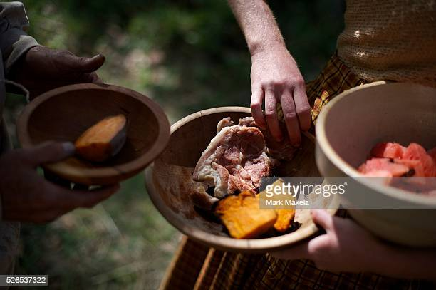 Civilian woman provides food to a soldier during the Battle of Perryville 150th Anniversary in Perryville, Kentucky.