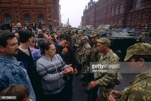 Civilians and military personnel hold a demonstration outside the Kremlin where tanks have formed a roadblock during a 1991 coup attempt. The State...