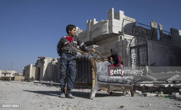 Civilians are seen in the Syrian town of Al Bab after the town center has been entirely freed from Daesh terrorists by Free Syrian Army backed by...