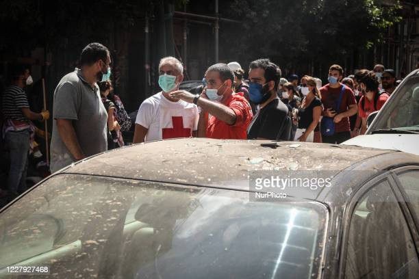 Civilians are seen the day after a massive explosion at the port on August 5, 2020 in Beirut, Lebanon. According to the Lebanese Red Cross, at the...