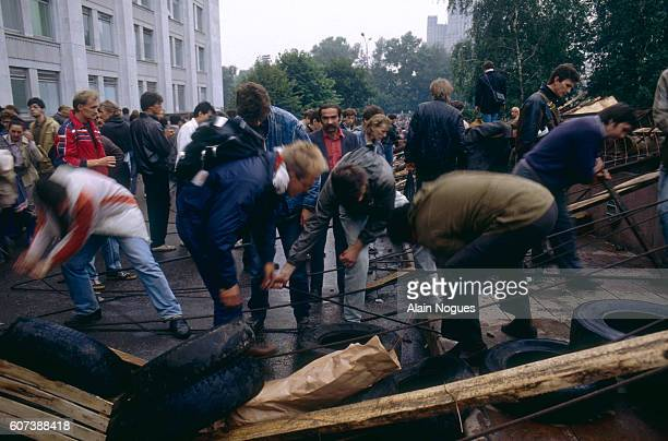 Civilians build a barricade at demonstrations outside the Kremlin during a 1991 coup attempt. The State Committee for the State of Emergency, a group...
