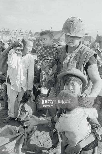 Civilians Evacuated from Khe Sanh Khe Sanh South Vietnam A US Marine escorts three Vietnamese children during evacuation of some 12000 civilians from...