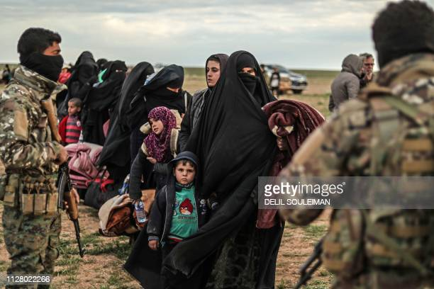Civilians evacuated from the Islamic State group's embattled holdout of Baghouz wait at a screening area held by the USbacked Kurdishled Syrian...