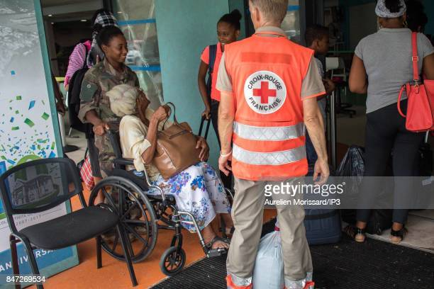 Civilians evacuated to Guadeloupe or Martinique airport nine days after the passage of hurricane IRMA on September 14 2017 in SaintMartin France