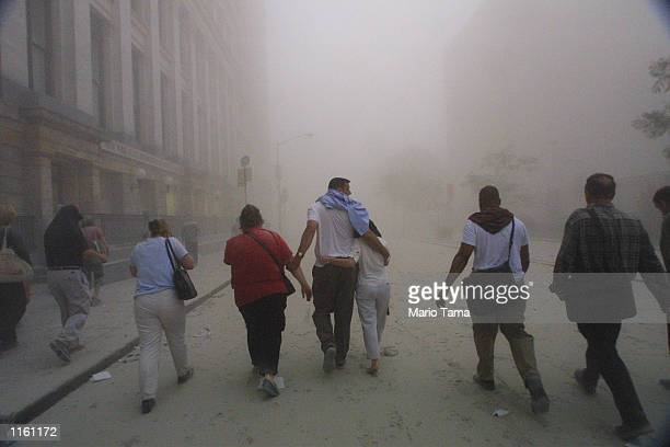 Civilians flee as a tower of the World Trade Center collapses September 11 2001 after two airplanes slammed into the twin towers in an alleged...